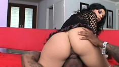 Striking brunette with a splendid ass impales herself on a black stick
