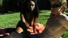 Dark skinned hottie has a white stud hammering her ass in the backyard